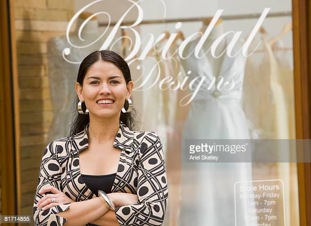 Hispanic woman in front of bridal business