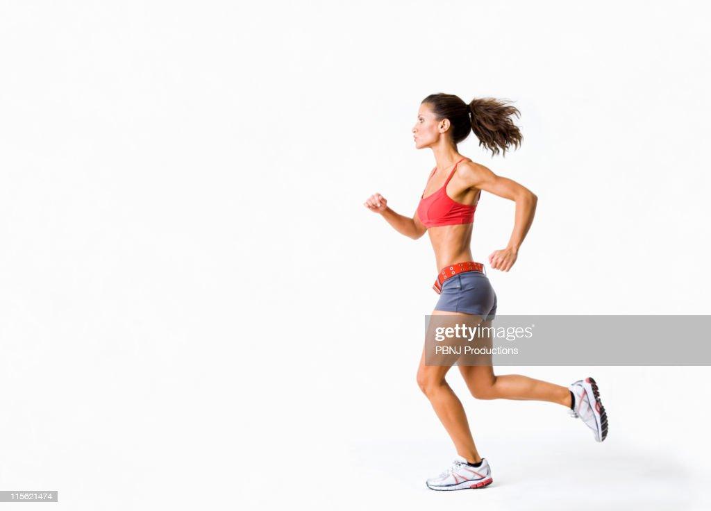 Hispanic woman in sportswear running : Stock Photo