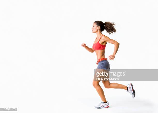 Hispanic woman in sportswear running