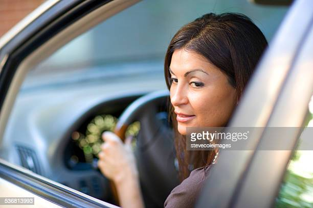 Hispanic woman looking back to for safety.