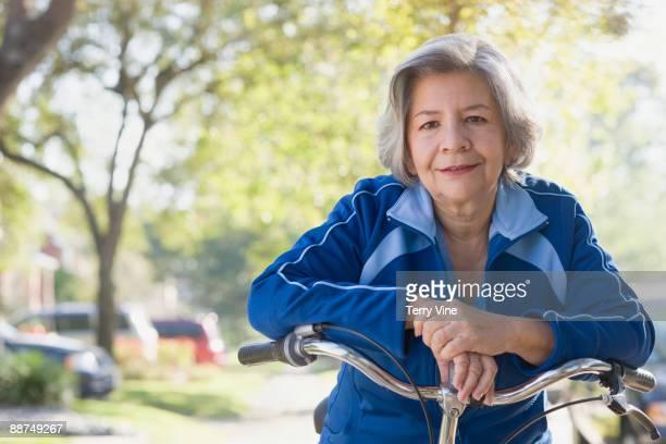 Hispanic woman on bicycle