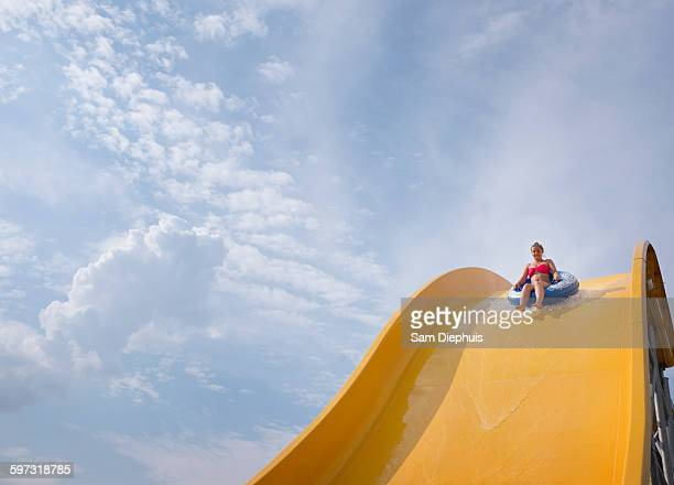 Hispanic woman on water slide