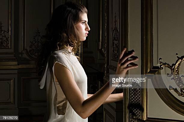 Hispanic woman opening a door