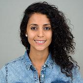 Studio shot of Hispanic woman standing