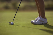 Hispanic woman playing golf