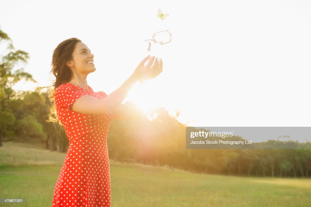 Hispanic woman playing outdoors
