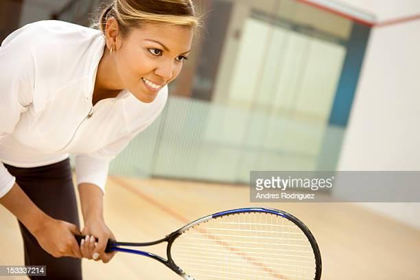 Hispanic woman playing squash