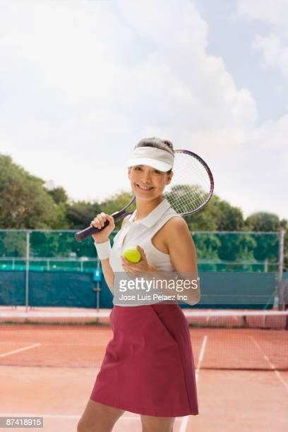 Hispanic woman playing tennis