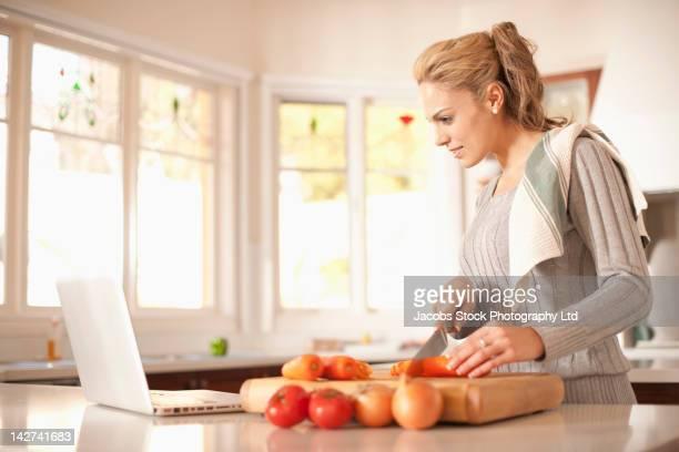 Hispanic woman preparing vegetables