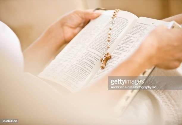 Hispanic woman reading bible