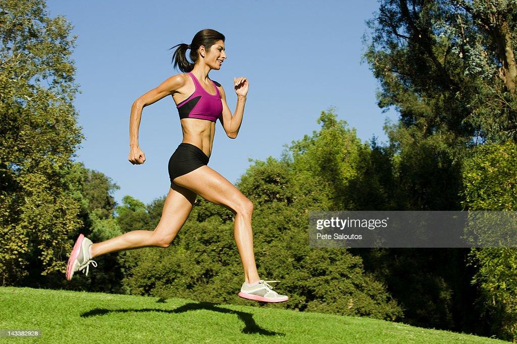 Hispanic woman running in park : Stock Photo