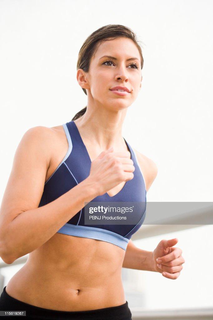 Hispanic woman running