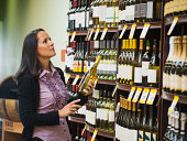 Hispanic woman shopping for wine