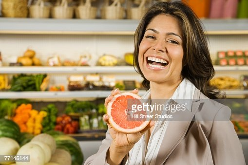 Hispanic woman shopping in grocery store : Stock Photo