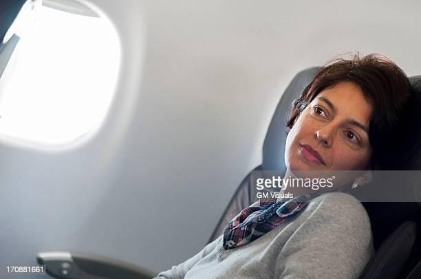 Hispanic woman sitting in airplane