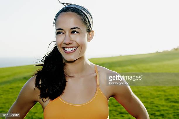 Hispanic woman smiling in field