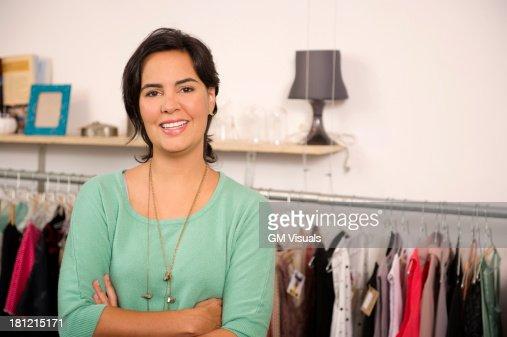 Hispanic woman smiling in shop : Stock Photo