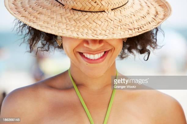 Hispanic woman smiling on beach