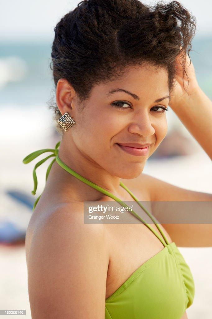 Hispanic woman smiling on beach : Stock Photo