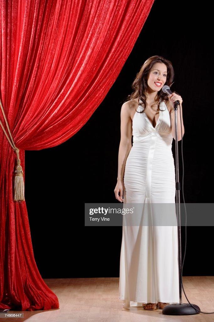 Hispanic woman speaking on stage : Stock Photo