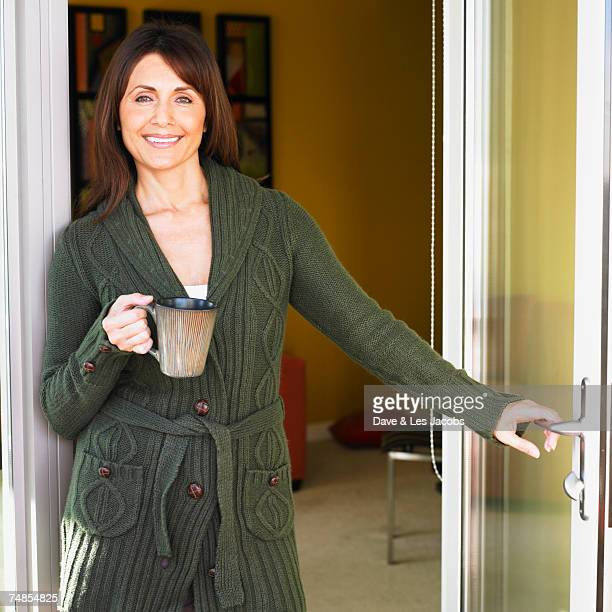 Hispanic woman standing in doorway