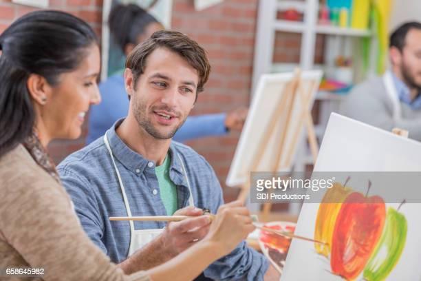 Hispanic woman takes an art class
