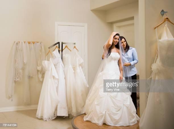 Hispanic woman trying on wedding dress