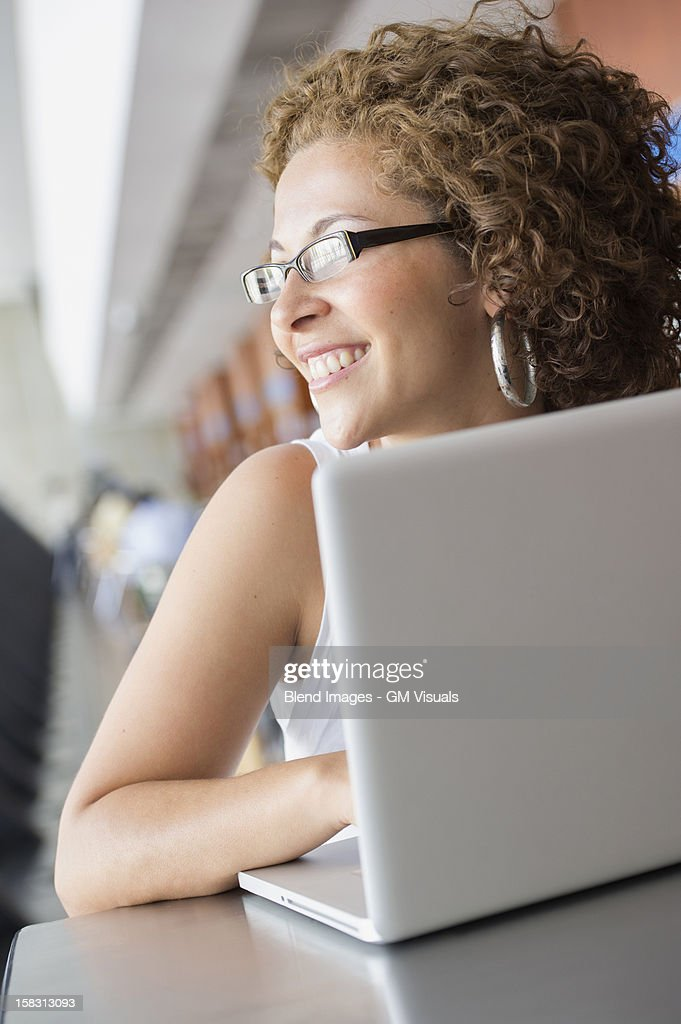 Hispanic woman using laptop : Stock Photo
