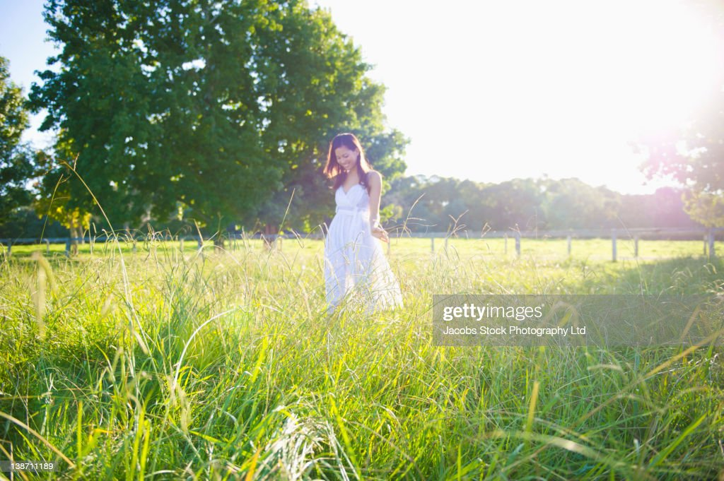 woman walking in grass - photo #8