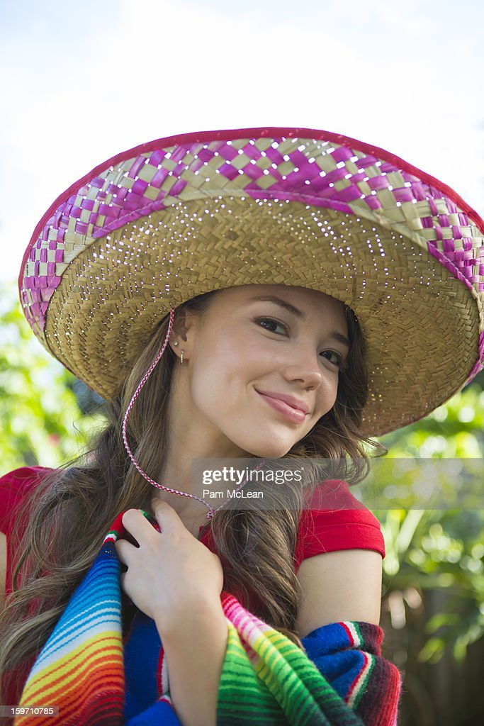 Hispanic woman wearing a sombrero : Stock Photo
