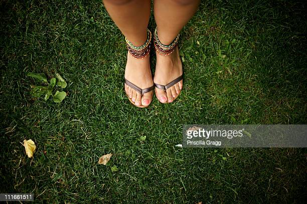 Hispanic woman wearing anklets and sandals