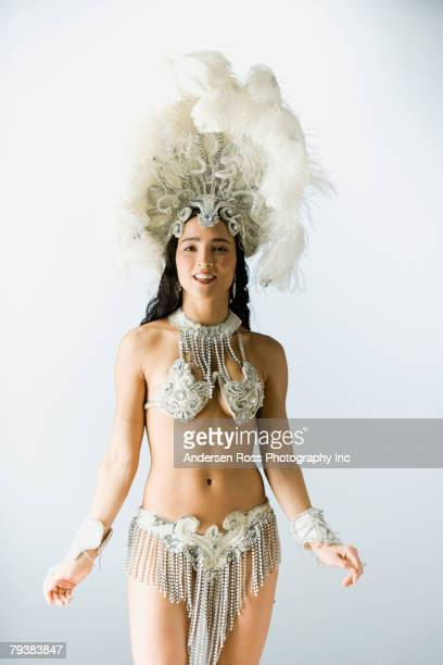 Hispanic woman wearing carnival costume