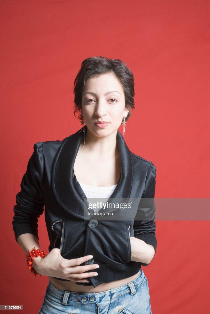Hispanic woman wearing funky jacket : Stock Photo
