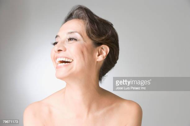 Hispanic woman with bare shoulders laughing