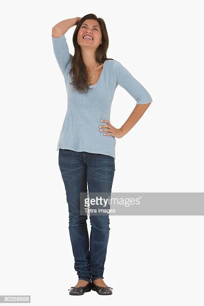 Hispanic woman with hand on head