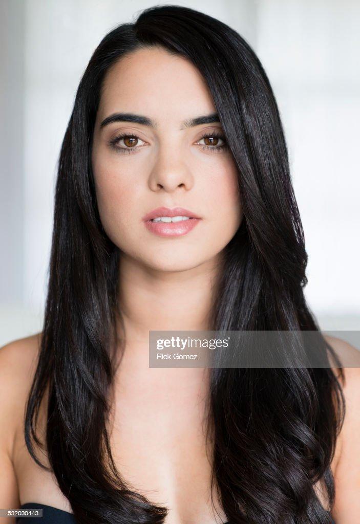 Hispanic woman with long hair smiling