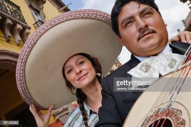 Hispanic woman with Mariachi player