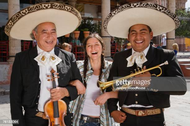 Hispanic woman with Mariachi players
