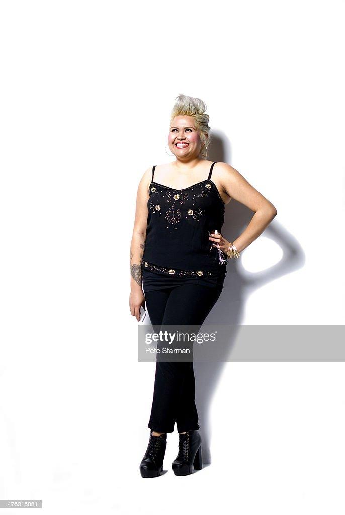 Hispanic woman with pompadour & tattoos. : Stock Photo