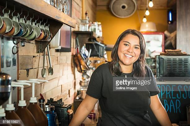 Hispanic woman working in coffee shop