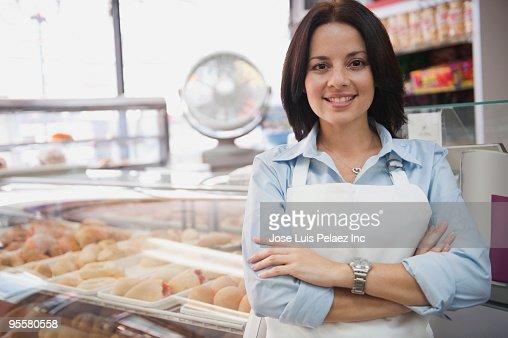Hispanic woman working in coffee shop : Stock Photo