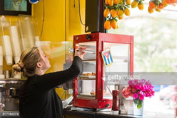 Hispanic Woman Working in Cuban Cafe on Calle Ocho Miami