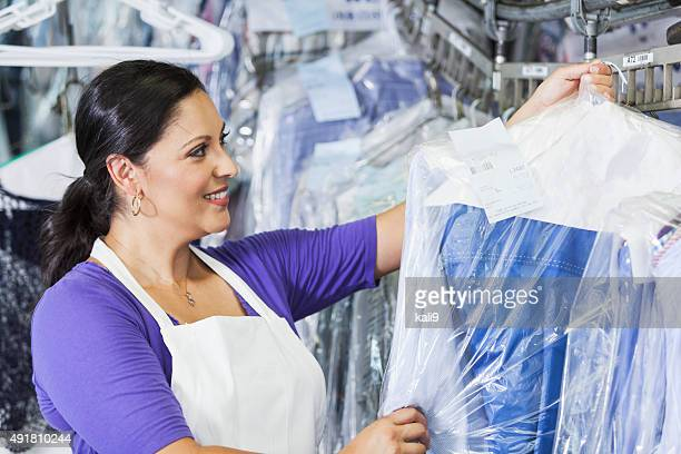 Hispanic woman working in dry cleaners