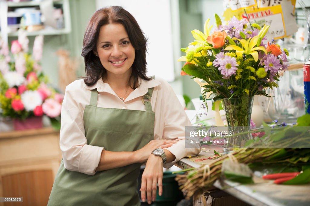 Hispanic woman working in florist shop : Stock Photo