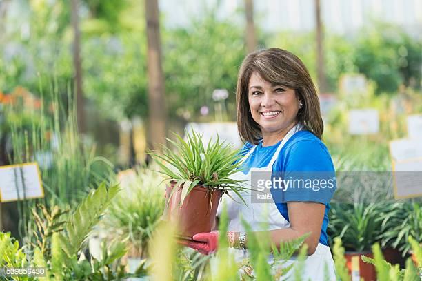 Hispanic woman working in garden center