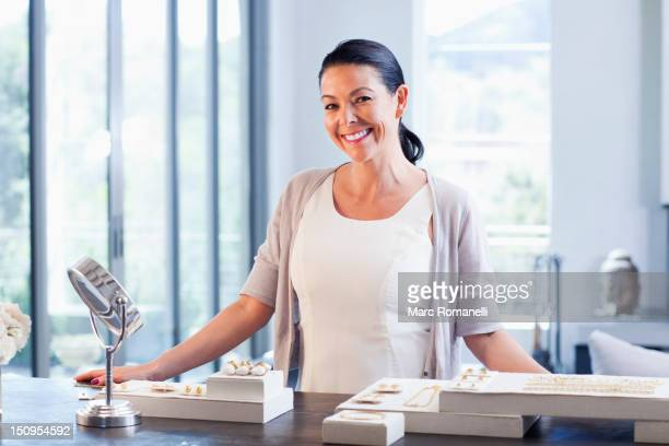 Hispanic woman working in jewelry store