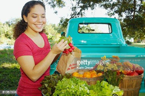 Hispanic women at organic farm stand : Stock Photo