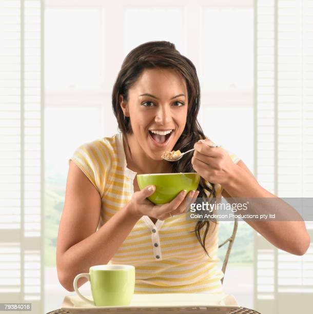 Hispanic women eating cereal