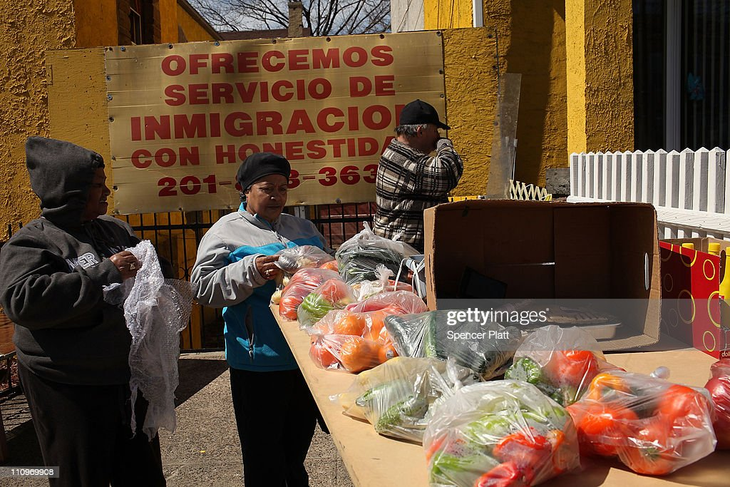 Hispanic women shop at a farmers market outside of a Latino church on March 28 2011 in Union City New Jersey Union City New Jersey one of the state's...