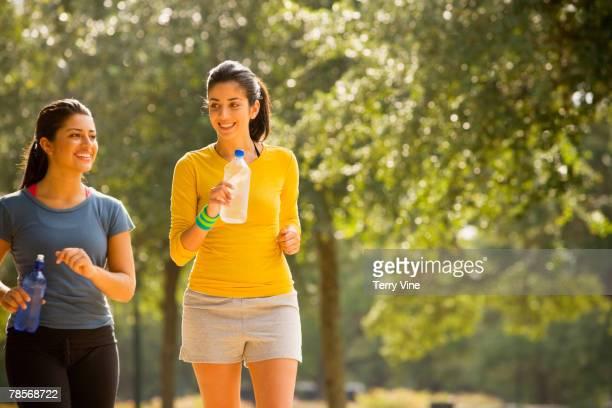 Hispanic women walking in park